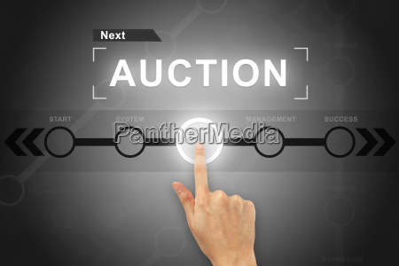 hand clicking auction button on a