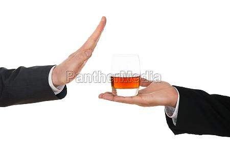 businessman avoiding alcohol