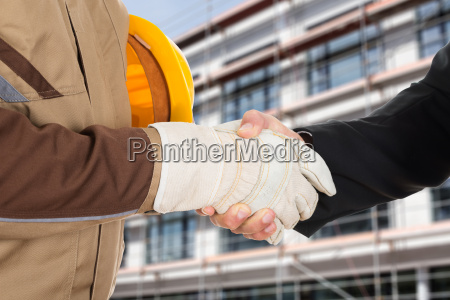architect and businessman shaking hands