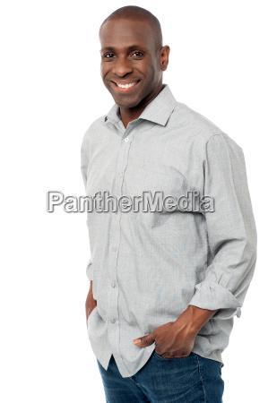 smiling man posing in casuals