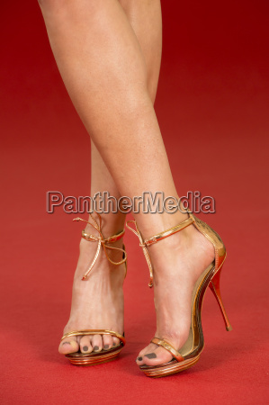 sexy legs in gold high heels