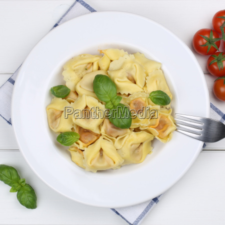 italian food tortellini pasta with basil