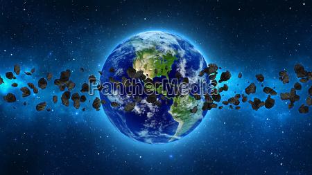 planeten erde mit asteroiden im weltall