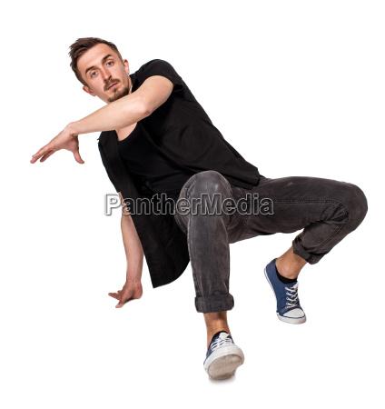 bruchtaenzer mit einer hand handstand vor