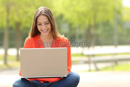 student girl working with a laptop
