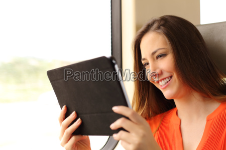 passenger woman reading a tablet or