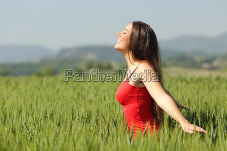 woman breathing fresh air in a