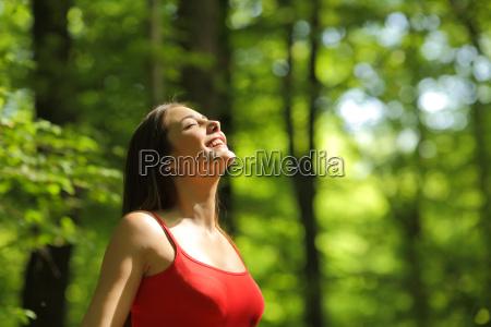 woman breathing fresh air in the
