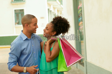 african american couple carrying shopping bags