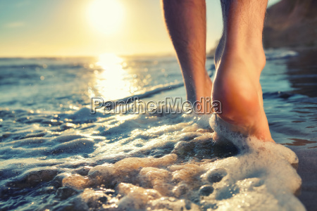 enjoying a barefooted walk at the
