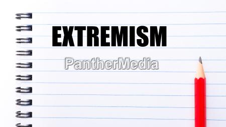 word extremism geschrieben auf notebook seite
