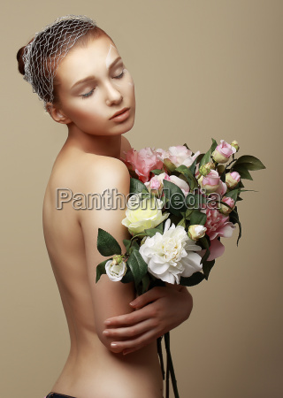young dreamy woman with bouquet of