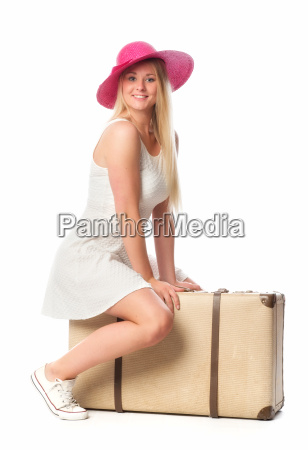 girl with hat sitting on a