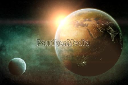 sonnenaufgang ueber planeten im weltraum