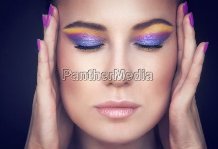 beautiful woman face with colorful makeup
