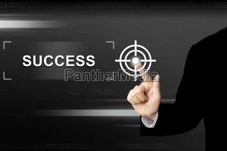 business hand pushing success button on
