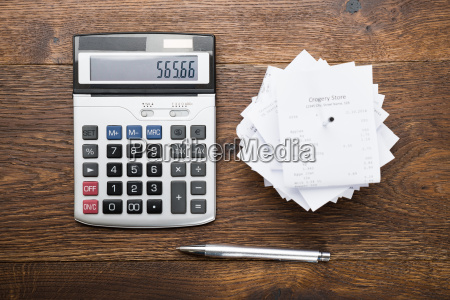 receipts with calculator and pen