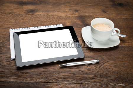 digital tablet and diary with cup