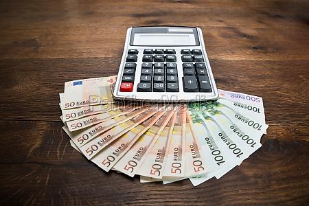 calculator and banknotes