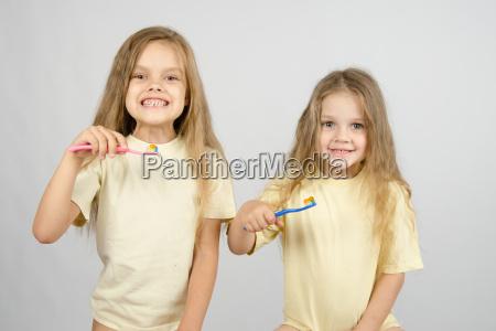 two girls are preparing to brush