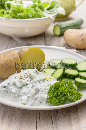 plate with boiled potatoes cream cheese