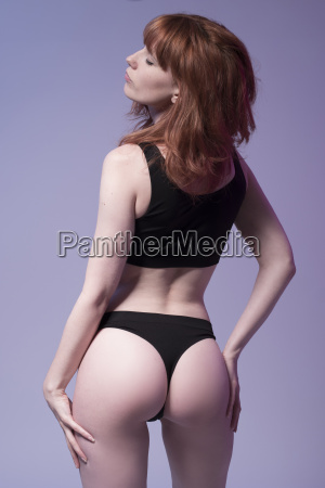 sexy redhead woman in fitness wear