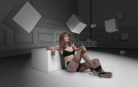 lingerie woman surrounded by 3d cube