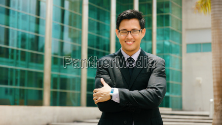 portrait chinese businessman with arms crossed