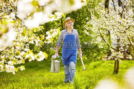 watering can spade cherry tree gardener