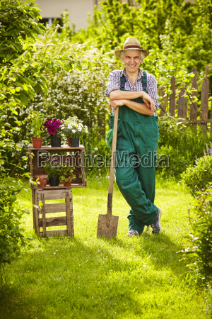 gardeners straw hat spade fence