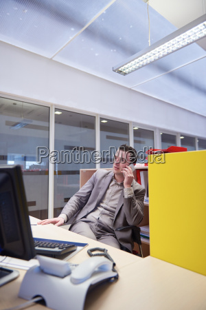 business man talking by phone in