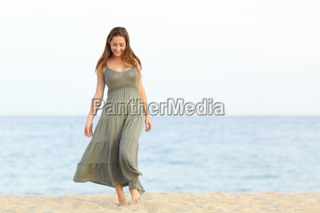 candid dreamer girl walking on the