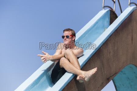 boy swimming pool fun