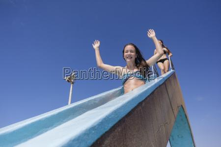 girl pool slide fun
