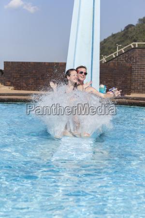 girl boy pool slide fun