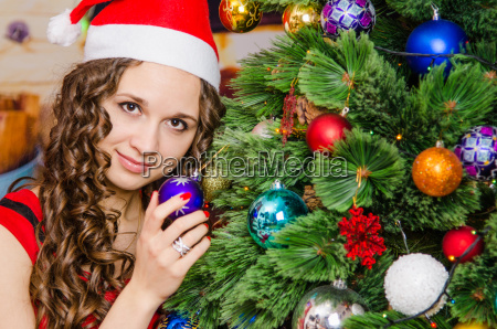 young girl holding a christmas tree