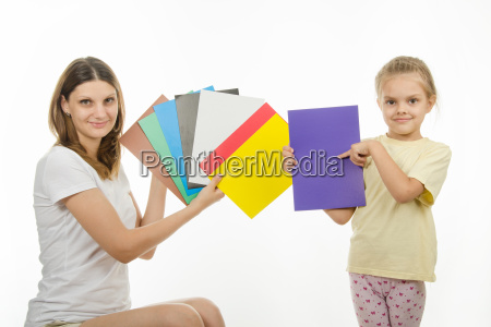 girl and girl are holding colorful