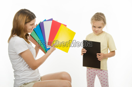 upset girl holding a black picture