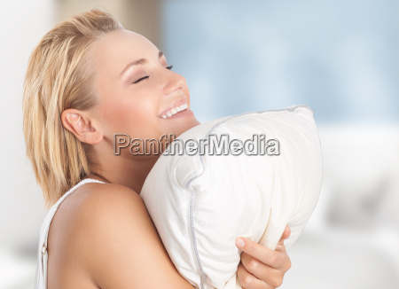 happy girl enjoying pillow