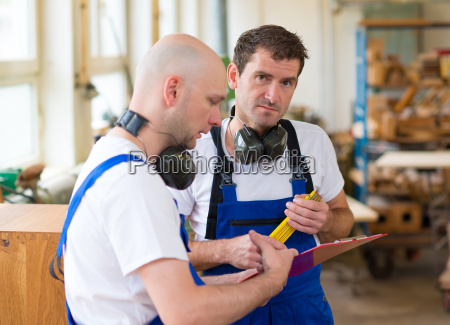 boss and worker in a carpenters