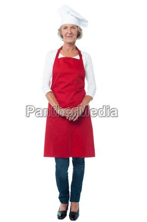 female chef posing over white