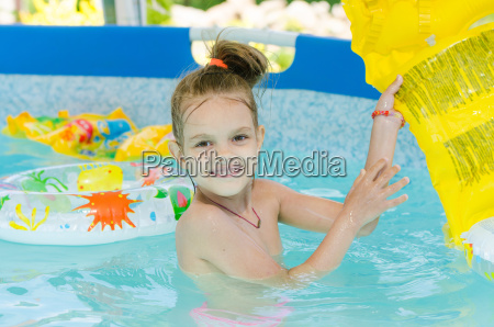 six year old girl bathing in