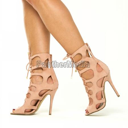 female legs in high heels ankle