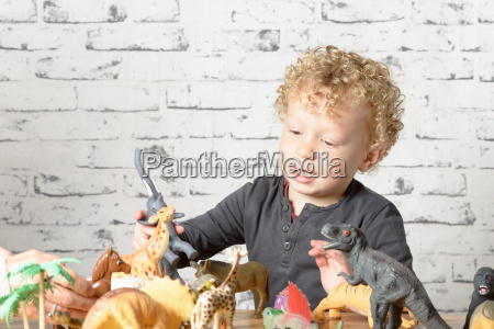 a little child plays with toys