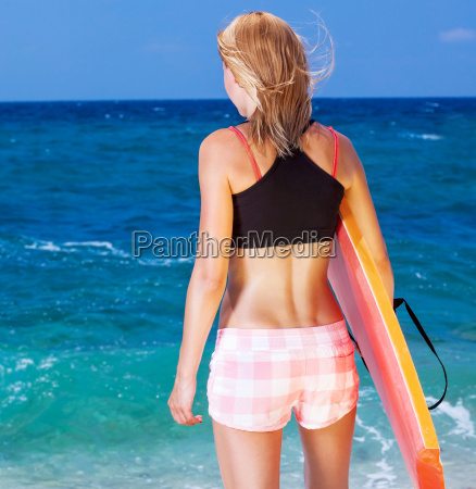 sportive woman on the beach
