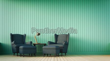 navy sofa und gruene wand mit