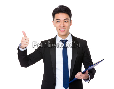 businessman hold with clipboard and thumb