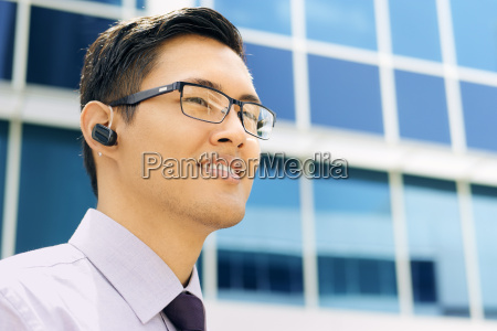business man with bluetooth handsfree device