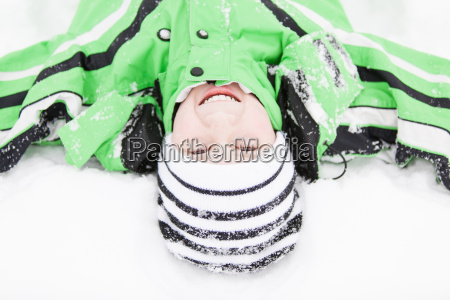 cute young boy enjoying the cold