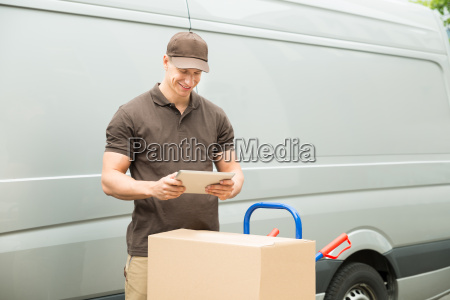 delivery man with digital tablet and